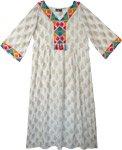White and Gold Folk Maxi Dress with Festive Tassel Neckline
